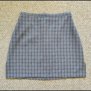 Pair of vintage 90s plaid and camo mini skirts